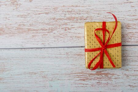 Christmas Gift Box Placed On Wooden Planks