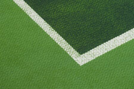 Tennis court indoor with green carpet surface