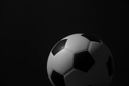 Closeup of football ball on black background