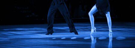 woman and man dancer latino international dancing. Blue filter