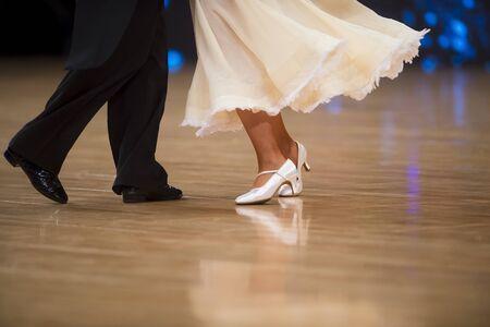 Couple feet of dancers. Woman and man latino dancing
