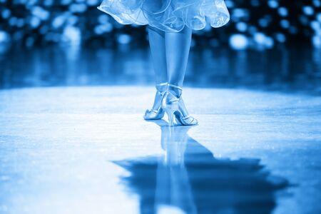 Woman dancer latino international dancing. Blue filter