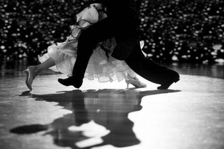 Woman and man dancer latino international dancing.Black and white filter Stock Photo