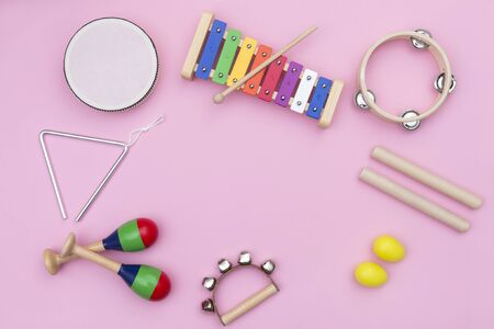 Musical instruments on pink background