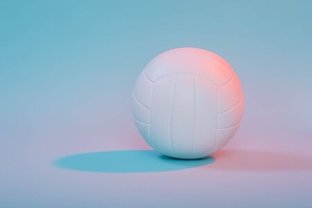 Volleyball ball isolated on neon background. Banner Art concept. Competition, draw.  Stock Photo
