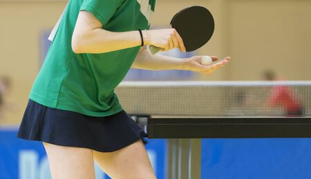 playing table tennis  racket and ball in a sport hall