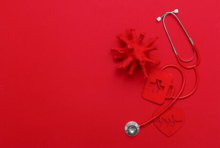Abstract Virus Strain Model, Heart And Stethoscope On red Background. Corona virus quarantine. Virus Pandemic Protection Concept