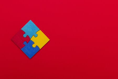 World Autism Awareness, concept with puzzle or jigsaw pattern on red background