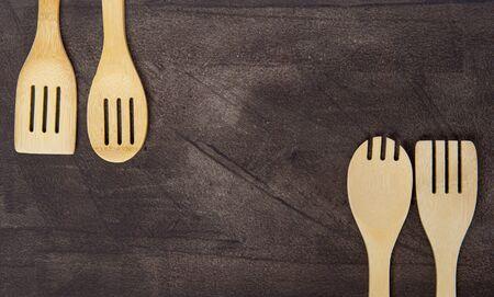 Top view of various wooden cooking utensils on grey background. Zero waste concept Reklamní fotografie