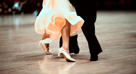 Man and woman dancer latino international dancing. Ballroom dancing is a team sport Stock Photo