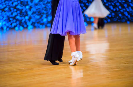 Man and woman dancer latino international dancing.  Ballroom dancing is a team sport 版權商用圖片