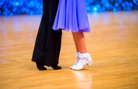 Attractive young couple of children dancing ballroom dance. Girl and boy dancer latino international dancing.