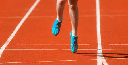Athletics man running on the track field. Sports and healthy lifestyle concept.