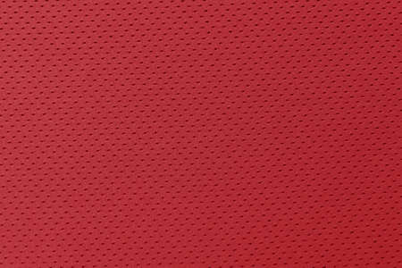 Red football, basketball, volleyball, hockey, rugby, lacrosse and handball jersey clothing fabric texture sports wear background 版權商用圖片