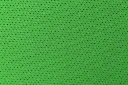 Green football, basketball, volleyball, hockey, rugby, lacrosse and handball jersey clothing fabric texture sports wear background 版權商用圖片