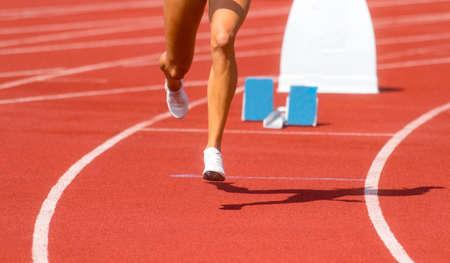 Runner in start position prepares for the start.  Individual sport conept Archivio Fotografico