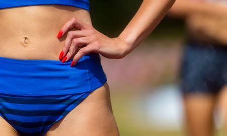 Young active runner woman dressed in sportswear prepare for the start. Archivio Fotografico