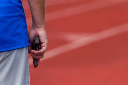 Hand firing a gun for starting race. Track and field concept 版權商用圖片