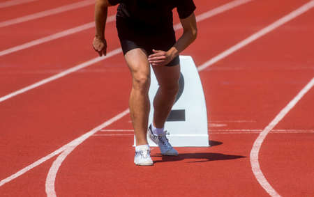 Runner in start position prepares for the start.  Individual sport conept 版權商用圖片