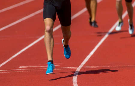 Composite image of close up of sportsman legs running. Individual sport concept Archivio Fotografico