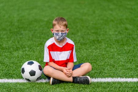 Football soccer training for kids. Boy running and kicking soccer ball. Young boy improving soccer skills Stockfoto