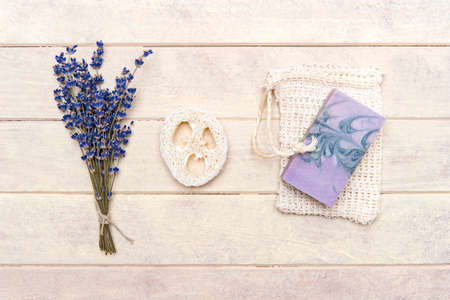 Natural handmade soap, loofah sponges with dried lavender and essential oil on wooden background. Zero waste concept 写真素材 - 158438129