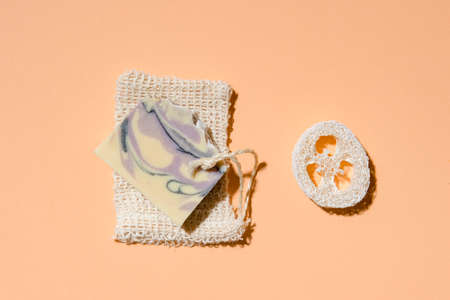 Handmade soap and loofah sponges on a beige background. Eco lifestyle concept. 写真素材 - 158438098