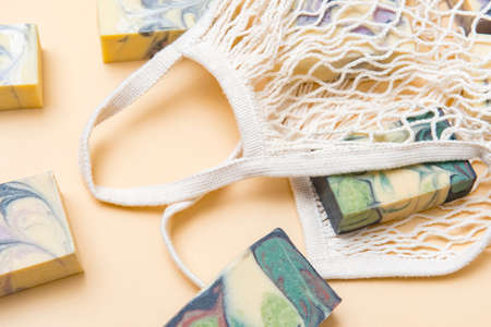 String bag or mesh bag with natural hand made soap. Zero waste, eco friendly cosmetics concept.