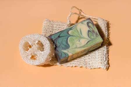 Handmade soap and loofah sponges on a beige background. Eco lifestyle concept. 写真素材 - 158438095