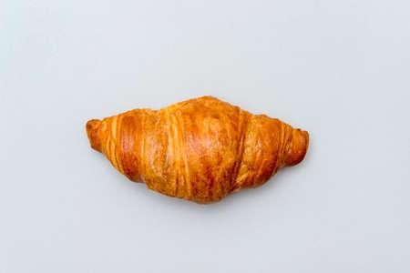 Fresh tasty croissant on grey background. French pastry 写真素材