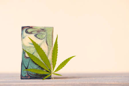 Homemade hemp soap and green leaf of marijuana. Spa organic soap. Organic skincare product with medicinal CBD. Zero waste concept 写真素材 - 158438453