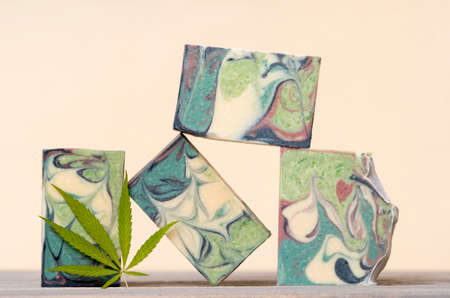 Homemade hemp soap and green leaf of marijuana. Spa organic soap. Organic skincare product with medicinal CBD. Zero waste concept 写真素材 - 158438168