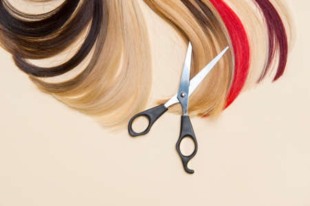 Hairdressing accessories scissors and a lock of hair. Hairdresser service 写真素材