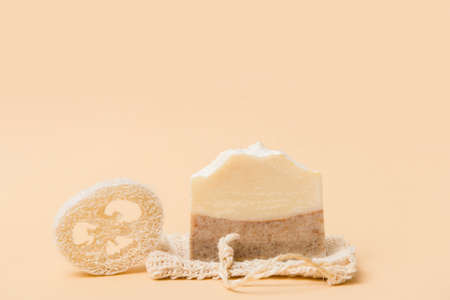 Handmade soap and loofah sponges on a beige background. Eco lifestyle concept. 写真素材 - 158474555
