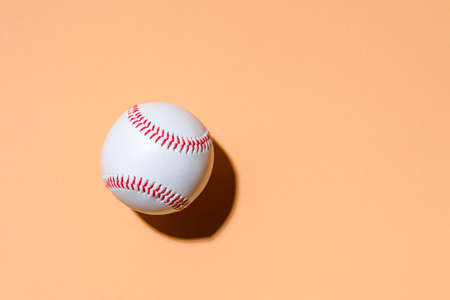 Close up of baseball ball on camel color background. Online workout concept. 写真素材 - 158437996