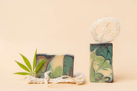 Homemade hemp soap and green leaf of marijuana. Spa organic soap. Organic skincare product with medicinal CBD. Zero waste concept 写真素材 - 158474556