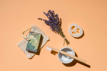 Top view of different hygiene and care items on cream color background, zero waste concept