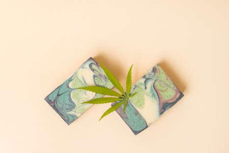 Homemade hemp soap and green leaf of marijuana. Spa organic soap. Organic skincare product with medicinal CBD. Zero waste concept 写真素材 - 158437999