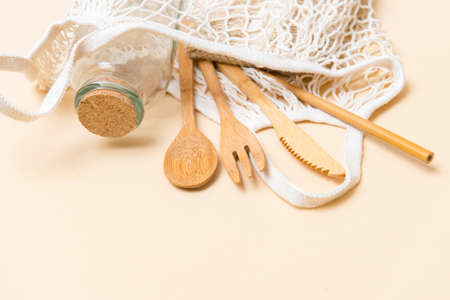 Mesh market bag with bamboo cutlery and water bottle. Sustainable lifestyle. Plastic free concept. Zero waste eco friendly cleaning kitchen theme 写真素材