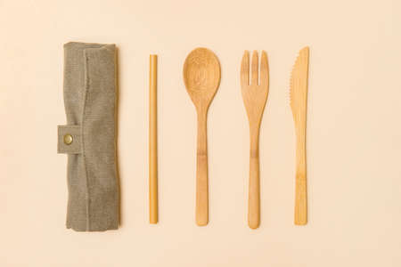 Set of Eco friendly bamboo cutlery on camel color background. Plastic free concept. Close-up, top view. 写真素材 - 158438281