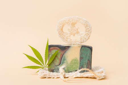 Homemade hemp soap and green leaf of marijuana. Spa organic soap. Organic skincare product with medicinal CBD. Zero waste concept 写真素材 - 158474613