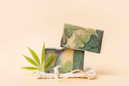 Homemade hemp soap and green leaf of marijuana. Spa organic soap. Organic skincare product with medicinal CBD. Zero waste concept 写真素材 - 158438004