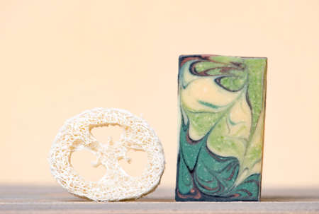 Handmade hemp soap and loofah sponges on a beige background. Eco lifestyle concept. 写真素材 - 158744637