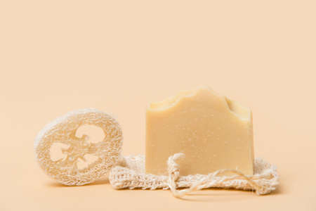 Handmade soap and loofah sponges on a beige background. Eco lifestyle concept. 写真素材 - 158722682
