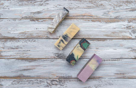 Handmade colorful soaps on wooden table background. Zero waste concept. 写真素材