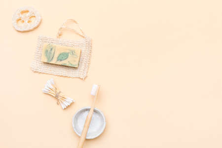 Zero waste bathroom accessories on cream color background. Natural eco bamboo product. Plastic free beauty essentials.