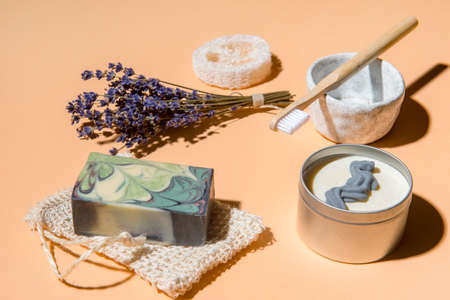 tTop view of different hygiene and care items on cream color background, zero waste concept