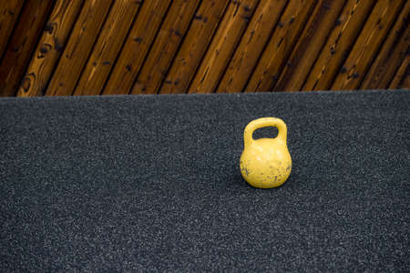Close up of dumbbell exercise weights on the floor at fitness gym with copy space. Workout online concept