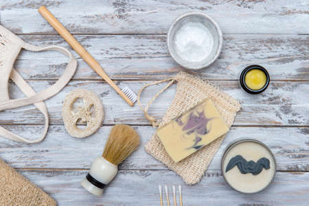 Zero waste bathroom accessories on wooden background. Natural eco bamboo product. Plastic free beauty essentials.