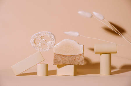 Handmade soap, loofah sponge and geometric shapes.  Sunshade shadow on beige background. Zero waste, eco friendly cosmetics concept. Eco lifestyle theme. 写真素材